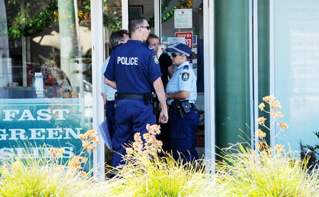 CRIME SCENE: Police at the Southern Cross Credit Union in Lennox Head in December 2008.