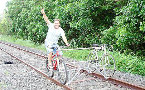 Julio Mottola rides his locobike along a section of the unused rail line at Byron Bay.