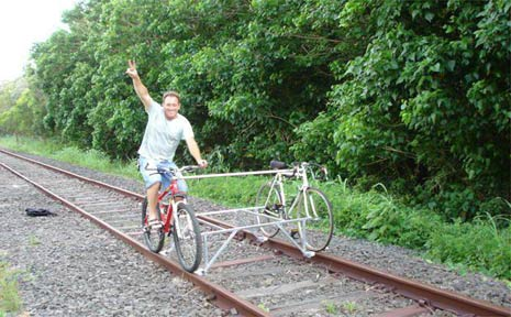 Julio Mottola rides his 'locobike' along a section of the unused rail line at Byron Bay.