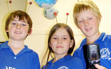 JOURNEY INTO SPACE: Empire Vale Public School students George Brown, Bethany Gillham and Jack Graham-Jones, embrace their National Science Week project to send messages via NASA into space.