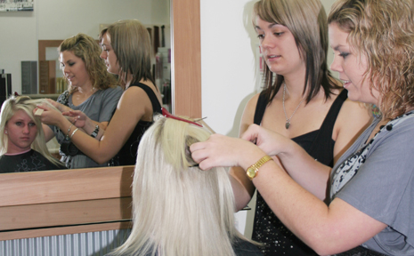 PREPARATIONS UNDERWAY: Senior stylists at Country Reflections Jessica Jackson and Angela Wilkie prepare Rhanna Elliott's hair for Saturday nights Hair Through the Ages extravaganza.