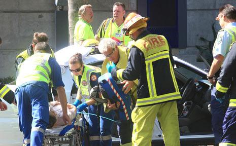A WOMAN was taken to hospital following this crash on Brett Street.