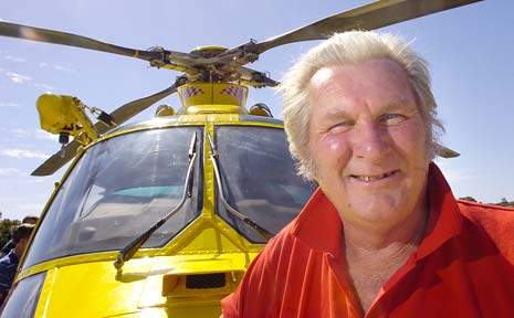 Wayne 'Dude' Ensbey, of Evans Head, in front of a Westpac helicopter that saved him from further injury when he was involved in a truck accident that left him with a broken neck.