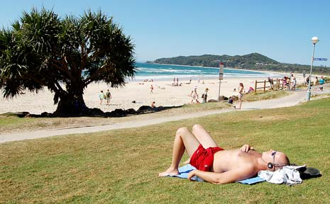 Kelly Taylor, of Suffolk Park, swelters in the heat at Byron Bay's Main Beach yesterday, but it was one of the coolest spots on the Northern Rivers.