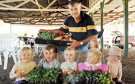 EARLY WIN: Gotta get'em kids eating their veggies from an early age, and they love them best if they enjoy their trips to the markets.