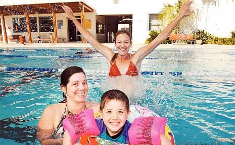 Enjoying a swim at the Lismore Memorial Baths are Carmilla Doran with her son Frank Schram, 3, and friend Briony Leonard.
