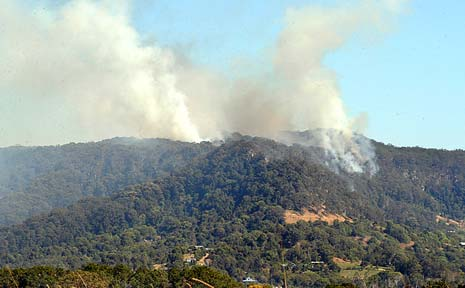 FIRE WARNING: Fires take hold on a mountain top near Mullumbimby on Tuesday. Extreme fire conditions are expected tomorrow.