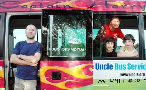 ON THE BUSES: Celebrating the new bus service for young people in the Byron Shire are UNCLE Project chief executive Mark Gasson (in doorway) with teenagers Jayden Polidano, Adam Lorimer and bus driver Harry Schollbach (rear).