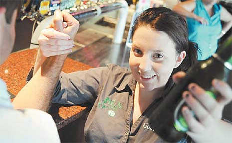 Ash Webb demonstrates her strength in an arm-wrestle at Dicey's.