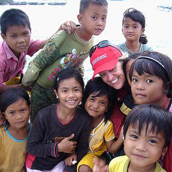 Coolum's Jill Hofmann has fun with local children on last year's trip to North Sumatra.