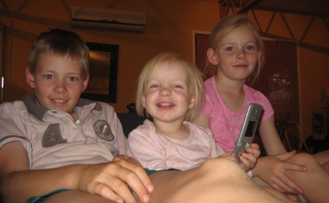 FEELING COOL: Taroom siblings Bae, 10, Yas, 20 months and Mia Lethbridge, 6, chilled out with the air con on during the recent heat wave, which saw records set for the hottest August day for Taroom when it hit 37 degrees.