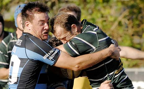 Ballina's Luke Sullivan and Lismore's Will Cotterill come to grips in the rugby union major semi-final on Saturday.
