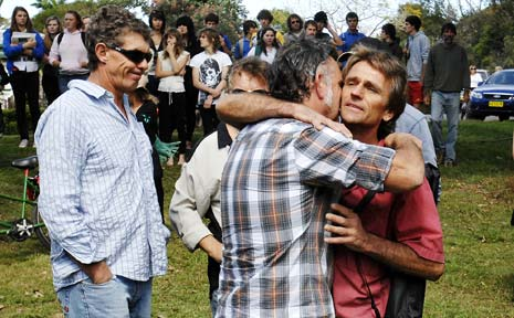 Jai Morcom's father, Steve Drummond, right, is supported by friends and relatives during yesterday's student walk-out at Mullumbimby.