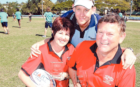 Thanks for everything.. Kathy and Lionel Alexander show off their awards for outstanding volunteer work with Paul Hickey, of NSW Touch.