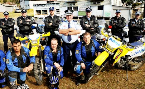 Steve Blair (centre) organises a small portion of the extra police in Kyogle yesterday for today's start of the Repco Rally. The 150 extra police include Highway Patrol and Traffic Support officers, the elite Trail Bike Squad and the Public Order Riot Squad.