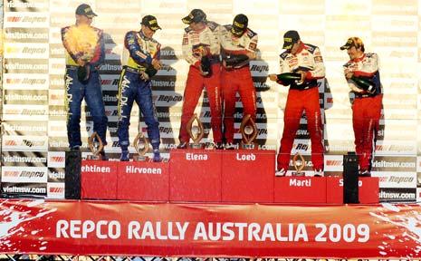 Jarmo Lehtinen (left), Mikko Hirvonen, Daniel Elena, Sebastien Loeb, Dani Sordo and Marc Marti celebrate at the end of the Repco Rally Australia.