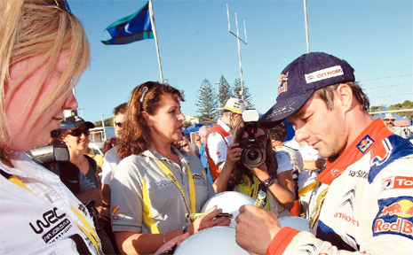 Sebastien Loeb signs autographs at the Repco Rally Closing ceremony at Kingscliff.