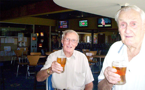 Tom Geoghegan (left) and Tom Edwards enjoy a beer or two at the Byron Bay Bowling Club.