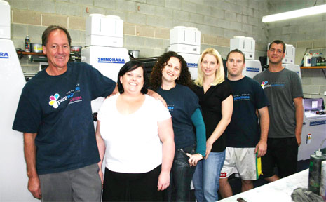 Owner of North Coast Print Solutions Tony Hill (left) with his dedicated staff.