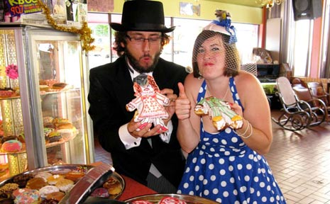 Juris Graney and bride Emma gave the thumbs up to their wedding day held at Portland's Voodoo Doughnut shop.