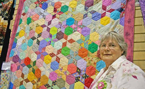 Jan Allen with her wrapping paper quilt.