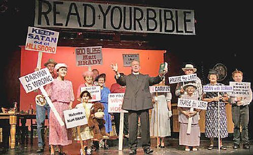 The Reverend Jeremiah Brown (Bill Graham) and Hilsboro townsfolk demonstrate outside the courtroom.