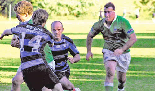 Lennox Head's left winger Matt Ahern takes the ball up team mate and loose head prop Corey Windle looms in support.