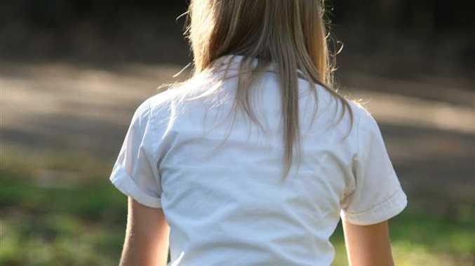 A schoolgirl meditates.