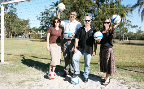 Trying to shed some light on the fields at New Brighton are (from left) vice-president of the Ocean Shores Junior Soccer Club Amanda Chamberlain, committee member Ted Kabbout, president Mark Patten and club registrar Julia Drennan.