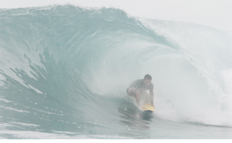 Neil Cameron deep in the tube at the Mentawais.