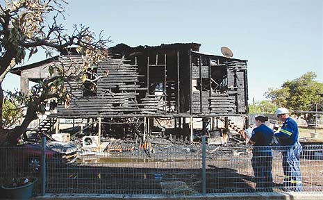 Sandra Thompson and her son William narrowly escaped a fire at their North Rockhampton home. Their valuables were not as fortunate.