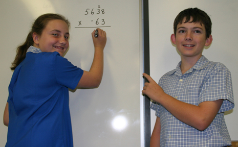 ADDING UP:Redeemer Luthern Primary School year seven students Bretany Appel and Cody Miles show why the school recevied excellent results in national numeracy and literacy tests
