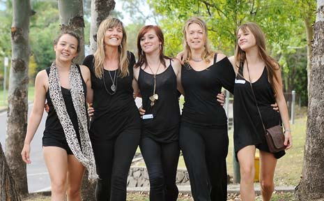 Students Caitlin Robinson (left), Ashleigh Atkinson (centre) and Sarah Marland (right) with Northern Rivers Area Health sexual assault councillor Jane McGowen (second from left) and Byron High teacher's aid Amie Dreyer (second from right).