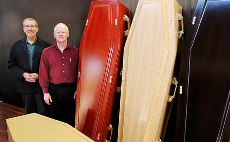 GREEN CHOICE: Office manager Steve Cooke (left) and business owner Lee Bassett, of South Lismore's Leaving Lightly, with a selection of cardboard coffins