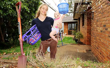 HIGHER COSTS: A relatively new resident to Lismore, Chloe Allan, and her nine-month-old daughter Hannah Toomey at home in their backyard.