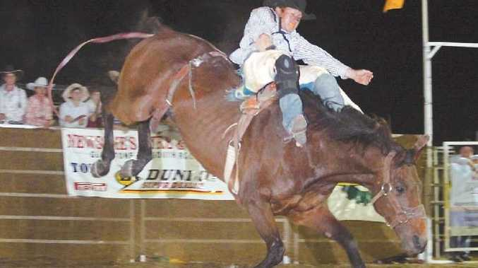 Will Comiskey is not sitting comfortably while competing in the Open Bareback ride.