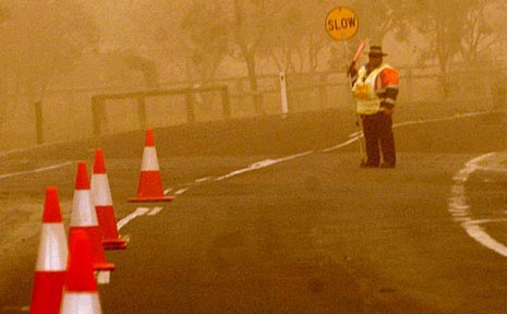 A dust storm blankets the Darling Downs yesterday.
