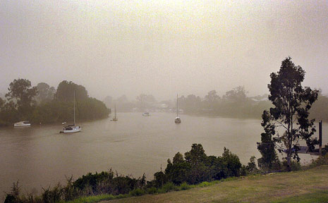 The Mary River as yesterday's dust storm reaches the Heritage City.
