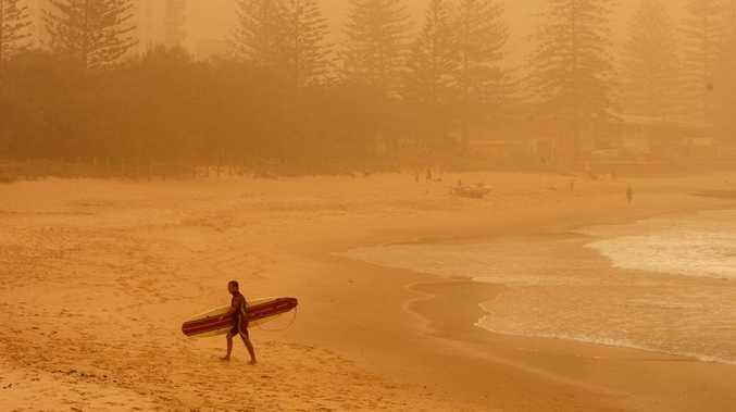 Dust shrouded Alexandra Headland beach in an orange glow on September 23.