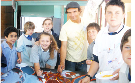 Aboriginal artist Anthony Walker teaches St Finbarr's students the use and meanings of key Aboriginal symbols.