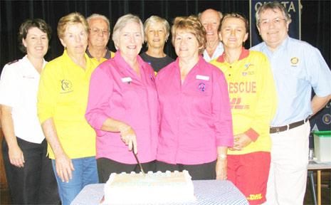 Volunteers cut a cake at the inaugural Volunteers Expo at Mullumbimby last weekend.