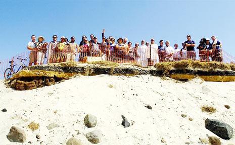 Belongil residents and their supporters gather last week at Belongil Beach.