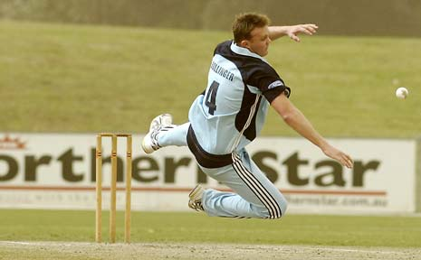 THERE IT IS, DOUG: NSW fast bowler Doug Bollinger gets in a tangle fielding off his own bowling.