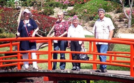 URSULA VON HEYMANN, Aina Apalais, Margaret Beeney and Andy Apalais on the bridge at the Toowoomba Japanese Gardens.