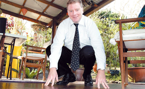 COOLANGATTA agent Anthony Davis shows off the infamous floorboards recycle in the Kingscliff house.