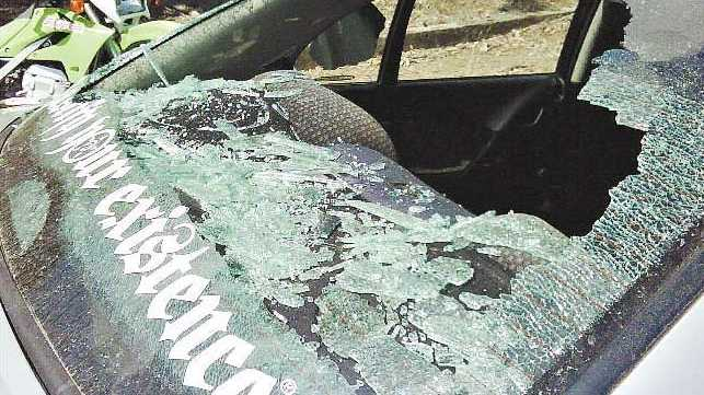 Cars belonging to QR workers were damaged by youths who hurled rocks at staff at the Glenmore rail yard.