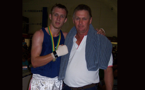 HARD HITTING EFFORT: Former Wowan boxer Lachlan 'Hinchy the Hitman'  Hinchliffe celebrates his state title with his dad Paul.