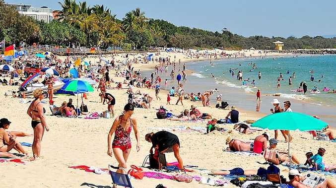A mum copped a warning after leaving her baby in the sun at Noosa Main Beach.