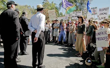Protesters for and against the Mullumbimby Woolworths development during a Land and Environment Court on-site inspection. 'Save our jobs' signs clashed with anti-Woolies slogans such as 'Woolworths, I won't shop there'.