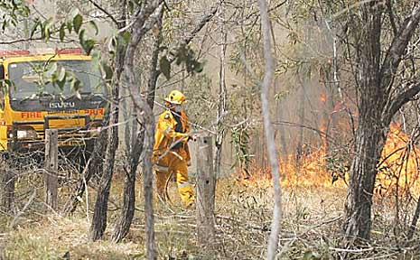 The Elliott Heads rural brigade contained a bush fire at Tammy Road, Moore Park, that was threatening two nearby houses.